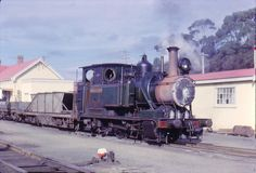 Mt Lyell Railway's Dubs (1896) Abt system rack-locomotive arrives in Strahan Tasmania with copper from Queenstown mines 1962.