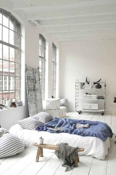 All white bedroom. Rustic urban Japanese industrial
