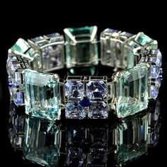 Circa this Oscar Heyman bracelet is ridiculous. It's got five huge step-cut aquamarines (approximately 130 carats, total) flanked by 20 square- and five round-cut sapphires. All set in platinum. Heyman and Sapphire Bracelet Art Deco Jewelry, I Love Jewelry, Jewelry Box, Jewelry Bracelets, Jewelry Accessories, Fine Jewelry, Jewelry Design, Bow Bracelet, Bullet Jewelry