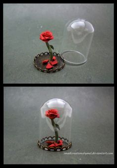 Just a little rose in the bell jar =].  Remind you of anything? hehe This can be made into a pendant.  The whole piece measures about 1 inch tall and is handmade from polymer clay.