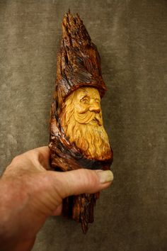 This is a Wood Carving of a Wood Spirit Elf Wizard. He would would be the perfect Rustic Log Cabin Wall Decor. I am Gary Burns the Treewiz and I carve everything in my shop. I have been carving full time since 1978. I love carving especially these Elf Wizards! I introduce to you Rooty the Elf Wizard. Hes a very funny Elf Wizard. He is always cheery and passes wonderful energy to all who are around him. Rooty has quite a sense of humor and enjoys adding little quips to keep things light. He…