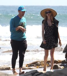Chris Martin,39 enjoyed a barefoot beach stroll with actress Heather Graham,45 in Malibu on Sunday