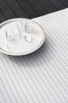 Woodnotes' In/out carpets are suited for all moist and humid conditions and for indoor use. The material is intended especially for outdoor use e.g. terrace, balcony and pool area. The Woodnotes In/out carpet has a soft feel and is transpiring therefore ideal for leisure living. Photo: In/out LINE carpet col. pearl grey-graphite. In & Out, Pearl Grey, How To Clean Carpet, Graphite, Carpets, Balcony, Things That Bounce, Terrace, Weaving