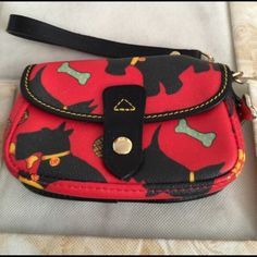 Authentic Dooney & Bourke Wristlet Used only once, Dooney Wristlet, perfect condition. Dooney & Bourke Bags Clutches & Wristlets