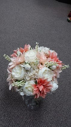 Coral and Cream Silk Wedding Bouquet. Gallery Florist and Gifts, Mebane, NC. www.galleryfloristandgifts.com