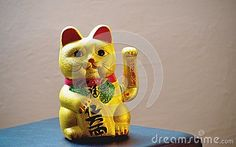 The maneki-neko  is a common Japanese figurine  which is often believed to bring good luck to the owner.