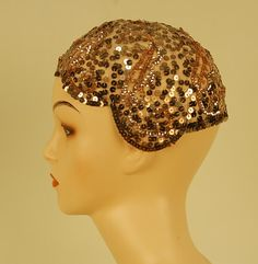 SEQUINNED NET FLAPPER SKULL CAP, 1920's cream with gold sequins in two sizes whitakerauction.com