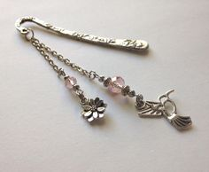 A personal favorite from my Etsy shop https://www.etsy.com/listing/261523489/hummingbird-bookmark-in-pink-beaded