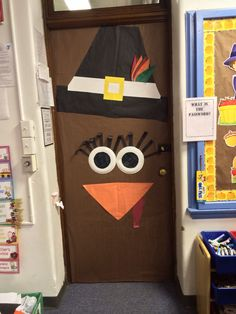 Turkey door Indian Headband and feathers instead of pilgrim hat Thanksgiving Classroom Door, Fall Classroom Door, Thanksgiving Door Decorations, Fall Classroom Decorations, Thanksgiving Bulletin Boards, School Door Decorations, Thanksgiving Preschool, Classroom Crafts, Thanksgiving Crafts For Kids