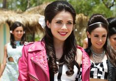"You don't dive into Disney Channel's Teen Beach 2 expecting to have your mind blown, so by the time the final twist is introduced, it's too late to prepare yourself. The sequel to Teen Beach Movie, which premiered Friday, begins simply enough: The first film's ""it"" couple — Mack (The Fosters' Maya Mitchell) and Brady (Austin & Ally's"