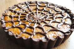 Chocolate spider web pumpkin pie