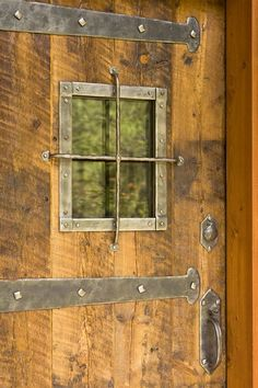 Rustic Gateway Design Take Care Of with Industrial Iron Strap and Large Distressed Nail Heads Great for sliding barn doors, barn door hardware and also other interior doors Rustic Entry, Rustic Exterior, Rustic Doors, Wooden Doors, Cabin Design, House Design, Cabin Doors, Rustic Cottage, Rustic Cabins