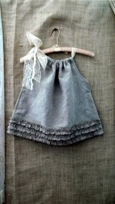 i bet this little baby dress would be SO simple to make. i love it!