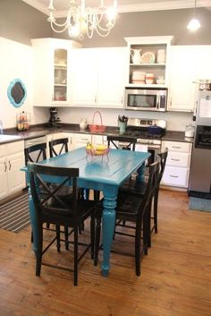 "thrifty turquoise dining table redo {before and after}::: easy DIY that changes the whole kitchen... Like the concept of a ""pow"" of colour, find something that's my style and a colour and there ya go"