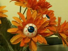 DIY Eyeball Flowers.  Excellent to dress up an empty vase thats otherwise in storage.