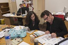 Left foreground, Corinne Rey, a cartoonist also known as Coco, is pictured working alongside cartoonist Bernard 'Tignous' Verlhac. In the background is the editor Stephane Charbonnier, who was killed alongside Mr Verlhac. Miss Rey was forced to give the gunmen the four-digit security code to the offices when they threatened to murder her daughter