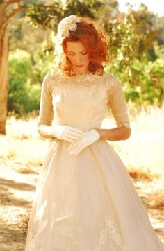 A vintage inspired wedding gown in lace and tulle with gloves, another great choice for those who love the. 50s like me.