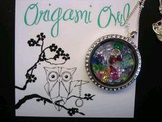 Just right for grandma - this Origami Owl locket has 27 birthstones.