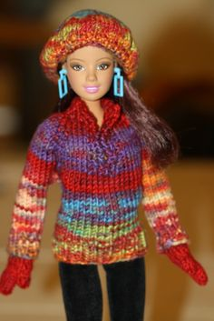 Sometime being stuck in bed has its benefits.  I hurt my back and had to take some very strong meds for pain and to relax the muscles.  All I could do during this time was knit.  This lovely yarn in vibrant fall colors made a gorgeous sweater, hat and mitten set. OOAK ensemble $35.00