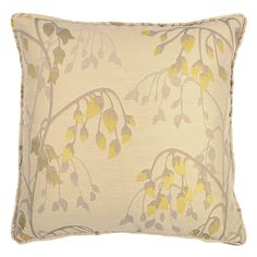 yellow drooping flower buds adorn this pale brown cushion.