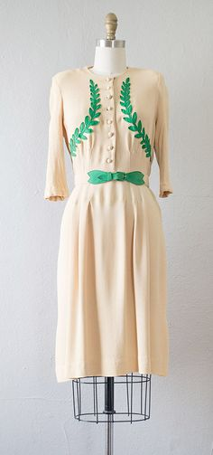 vintage 1930s dress with wonderful details - I would style this with black tights and booties to edge it up a little.