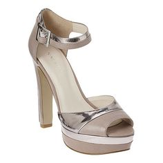 """Straight from the Runway!  Whitney Port featured this shoe at New York Fashion Week....Platform sandal with metallic accents and leather upper.  Adjustable ankle buckle closure.  Measurements: heel 5"""" and platform 1.5""""."""