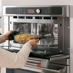 Image of woman placing bowl of rice in upper Advantium oven French Door Wall Oven, Electric Wall Oven, Single Oven, Oven Cleaning, Oven Racks, Fresh Vegetables, Rice, Favorite Recipes, Healthy Recipes
