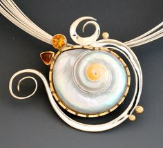 Forged pearly snail shell with citrines by Barbara Umbel (makes me think of ursala from the little mermaid movie)