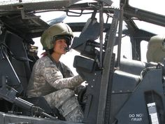 U.S. Army Chief Warrant Officer Stephanie Rose sits in an Apache attack helicopter