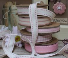 East of India cream ribbon with pink stitches