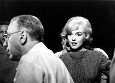 """Marilyn Monroe and director George Cukor on the set of """"Let's Make Love', 1960."""