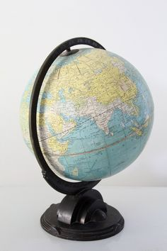 A Replogle world globe circa The 12 inch desk globe features a black art deco base and meridian. The tone of the globe is a beautiful pastel blue. - Standard Globe made by Replogle Globes - blac Globe Art, Map Globe, Vintage Globe, Vintage Maps, Desk Globe, World Globes, Pastel Blue, Pink, Or Antique