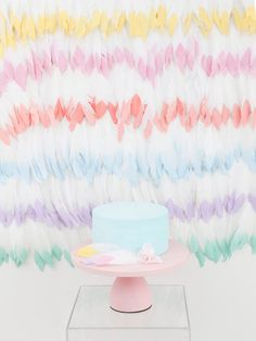 How to create a gorgeous DIY Mixed Pastel Feather Backdrop - perfect for a shower, birthday party, or mother's day brunch! Get details and more mixed pastel party ideas now at fernandmaple.com!