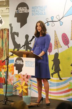 The Duchess of Cambridge, showed off her growing baby bump in  blue maternity dress by Seraphine as she gave a speech on child mental health at Roe Green Junior School in Brent, London