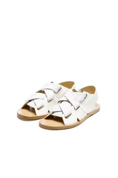 """Slingback Flat Leather Sandal Upper: Italian Cow & Lamb Leather Suede upper Soft tubular leather straps with metal eyelets Leather sole 1/2"""" stacked leather Slip on style"""