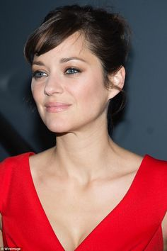 Radiant: The actress wore her hair in a stylish bun and wore a sweep of bronze eyeshadow and a pink lipstick