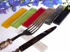 Cutlery rest in colorful glass for fine dining table setup. By Glass Studio