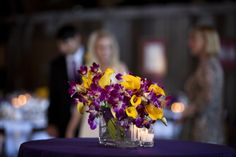 yellow and purple bridesmaids bouquets. Use on the tables as decoration during the reception