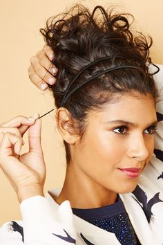 Curly Styles That Kick Humidity To The Curb #refinery29  http://www.refinery29.com/curly-hair#slide14  If there are curls sticking out on the side, twist and pin them down. But, leave the curls out in the back to create that shape and volume.