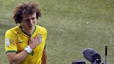 Brazil's David Luiz leaves the pitch after the World Cup semifinal.