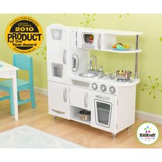 KidKraft White Vintage Kitchen - 53208 - The KidKraft White Vintage Kitchen is a classic play kitchen with the sophisticated look of the past and modern amenities of the present. Even though ...