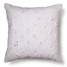 """The Flower Applique Throw Pillow 18""""x18"""" in White from the Pillowfort Tropical Treehouse collection adds a real dash of class and sophistication to your child's bedroom. The kids' throw pillow has 3D flowers in white that flutter off of a white background. The square pillow adds a lovely, serene touch to the bedroom."""