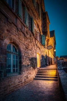 On a summer night in Mont Saint Michel you can find the quiet peaceful harmony. In the daytime tourists buzz around the medieval town. Photo...
