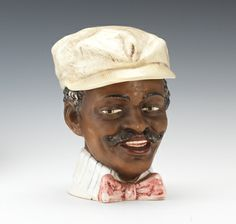 A Black Majolica Head with Mustache Tobacco Jar
