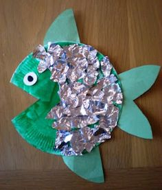 This is a craft that could be done based off of the bookRainbow fish. What you would need is a paper plate, any color construction paper, and some cute stickers to put on their fish.  What you would do is cut out a little triangle for the mouth, and with the construction paper. Make fins. Let the kids color their fish with markers and put stickers where ever they woul dlike.