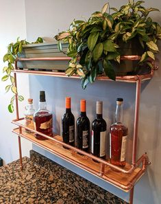 Inspired by one of our favorite authors, the Hemingway copper shelves are the perfect way to display your drink of choice or your mini-herb garden. These shelves are made of genuine copper and birch, which has been coated to prevent spill damage.  Requires light assembly; connect