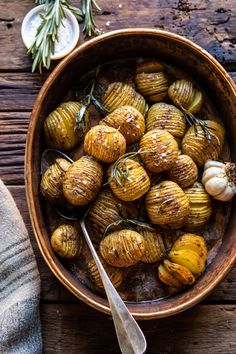 """The most perfect Crispy Rosemary Butter Roasted Potatoes. The secret? Thinly slicing the potatoes into a """"Hasselback"""" and oven roasting at high heat. YUM!"""
