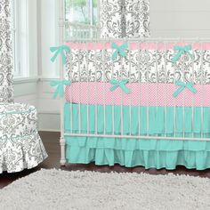 Such a sweet color pallet for a nursery! I adore grey with a touch of pink and teal. Gray and Teal Damask Crib Bedding | Carousel Designs   #babygirl #carouseldesigns