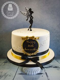 Tinkerbell cake given a grown up makeover for a 30th birthday, with a swish of gold beads and edible glitter, a pretty framed name, and very grown up black and gold colour scheme