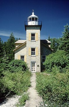 Bois Blanc Island Lighthouse, built in 1867, is located on a peninsula on the north side of Bois Blanc Island in Lake Huron, off the coast of Cheboygan, Michigan.